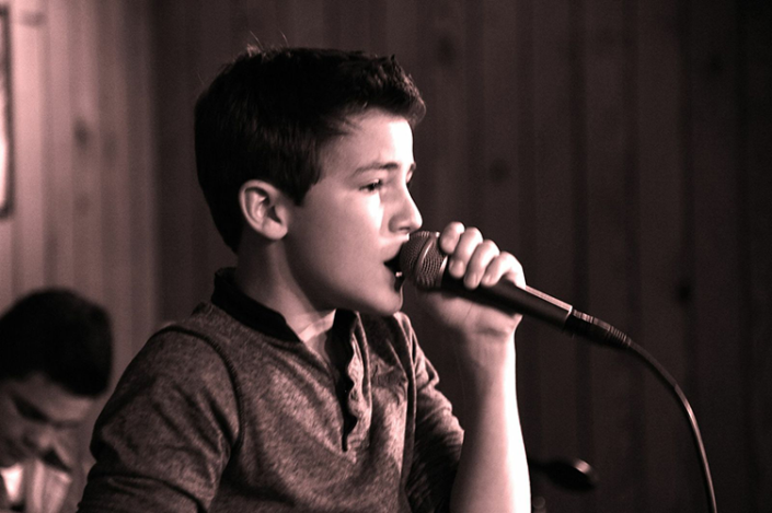 Alex B. Singing Live