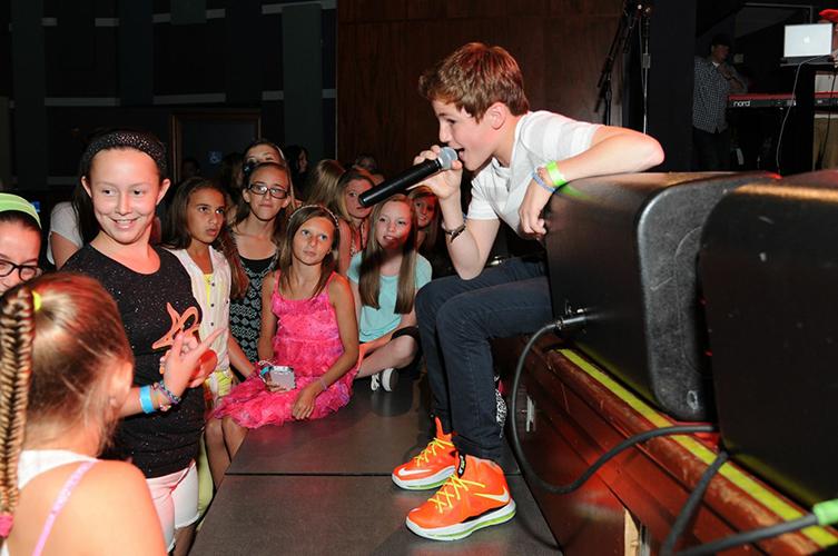 Alex B. sings to crowd
